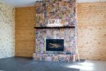 камин в доме из сип панелей
