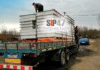 Доставка СИП-панелей из ЦСП манипулятором в Кипень